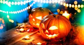 Halloween pumpkin head jack lantern with burning candles Royalty Free Stock Photography