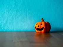 Halloween pumpkin head on the wooden table. the background is blue and copy space for text Royalty Free Stock Photo