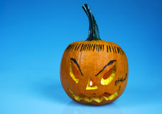 Halloween pumpkin on isolated blue.Horizontal. Royalty Free Stock Images