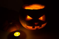 Halloween pumpkin jack  lantern with candle on dark. Backgrounds Stock Images