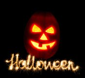 Halloween pumpkin jack-o-lantern candle lit and the inscription Royalty Free Stock Photos
