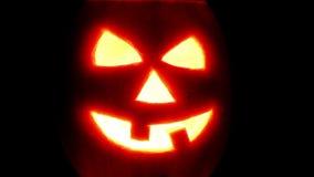 Halloween pumpkin jack-o-lantern candle lit stock video