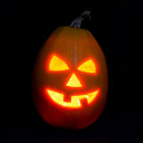 Halloween pumpkin jack-o-lantern candle lit, isolated on black Royalty Free Stock Images