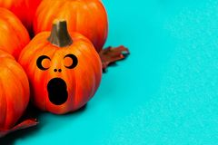 Halloween pumpkin jack o lantern decor with funny faces. Halloween holiday background. Halloween pumpkin jack o lantern decor with funny faces on blue royalty free stock photography