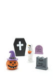 Halloween pumpkin Jack O' lantern, graves, mummy, and coffin on white background. Royalty Free Stock Photo