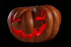 Halloween pumpkin Jack O Lantern shiny inside on black Royalty Free Stock Photography