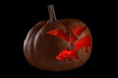 Halloween pumpkin Jack O Lantern shiny inside on black Royalty Free Stock Image