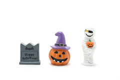 Halloween pumpkin Jack O' lantern, grave, mummy on white background. Royalty Free Stock Image