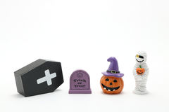 Halloween pumpkin Jack O' lantern, graves, mummy, and coffin on white background. Stock Photo
