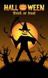 Halloween pumpkin killer in a graveyard Royalty Free Stock Photo