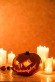 Halloween pumpkin lantern and candles Stock Photo