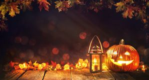 Halloween pumpkin with lantern on wooden royalty free stock images