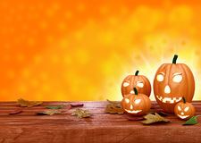 Halloween pumpkin lanterns on orange background Stock Photos