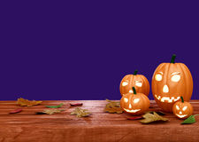 Halloween pumpkin lanterns on wooden desk Royalty Free Stock Photography