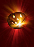 Halloween pumpkin and light rays Royalty Free Stock Photo