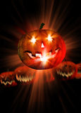 Halloween pumpkin and light rays Royalty Free Stock Images