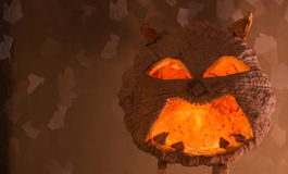 Halloween pumpkin. With a light into the shadows, orange-yellow background Stock Image