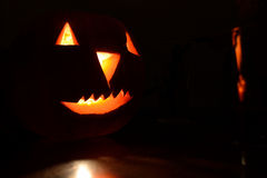 Halloween pumpkin lighted with a candle Stock Image