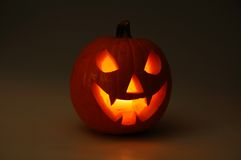 Halloween pumpkin lit by candlelight. Scary face cut into pumpkin for Halloween (lit from the inside Royalty Free Stock Photography
