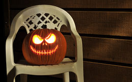 Halloween Pumpkin Lit on Porch Royalty Free Stock Image