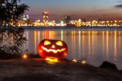 The halloween pumpkin at the night city Royalty Free Stock Image