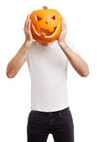 Halloween pumpkin on man head, joking Royalty Free Stock Photography