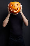 Halloween pumpkin on man head Royalty Free Stock Photography