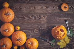 Halloween pumpkin man with knife and fork Stock Images
