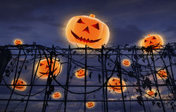 Halloween pumpkin and metal fence with dry leaves Royalty Free Stock Photography