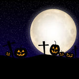 Halloween pumpkin at midnight with a full moon Royalty Free Stock Images