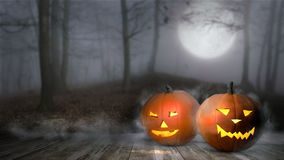 Halloween pumpkin in mist forest. Jack lantern with candle light inside in mystical forest. Halloween pumpkin in mist forest. Jack lantern in mystical forest Stock Photos