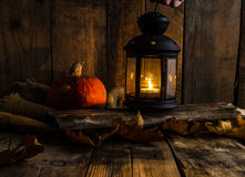 Halloween pumpkin moody picture with lantern Royalty Free Stock Photo