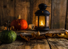 Halloween pumpkin moody picture with lantern Stock Photos