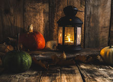 Halloween pumpkin moody picture with lantern Stock Images