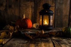 Halloween pumpkin moody picture with lantern Royalty Free Stock Photos