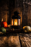 Halloween pumpkin moody picture with lantern Stock Image