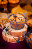 Halloween Pumpkin Muffins Decorated with Spiders and Spider Web Royalty Free Stock Image