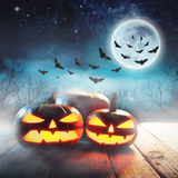 Halloween Pumpkin In A Mystic Forest At Night. With moon. Elements of this image furnished by NASA Royalty Free Stock Photo