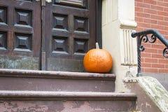 Halloween pumpkin near the door Royalty Free Stock Images