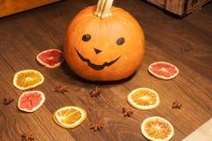 Halloween pumpkin, near dried fruits Stock Images