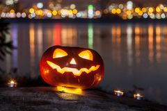 The halloween pumpkin at the night city Stock Photo