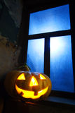 Halloween pumpkin in night on old wood room Royalty Free Stock Photos