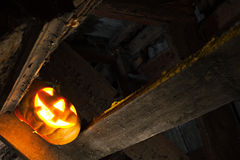 Halloween pumpkin in night on old wood room Royalty Free Stock Image