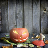 Halloween pumpkin on old grunge boards Stock Photo