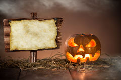 Halloween Pumpkin on old wooden table Royalty Free Stock Photography