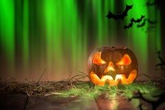 Halloween Pumpkin on old wooden table Stock Photos