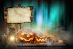 Halloween Pumpkin on old wooden table Royalty Free Stock Photos