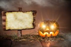 Halloween Pumpkin on old wooden table Stock Photo