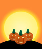 3 Halloween pumpkin on orange background with castle. 3 Halloween pumpkin made from clay or plasticine on orange fullmoon background background Stock Photo