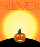 Halloween pumpkin on orange background with text Royalty Free Stock Photo